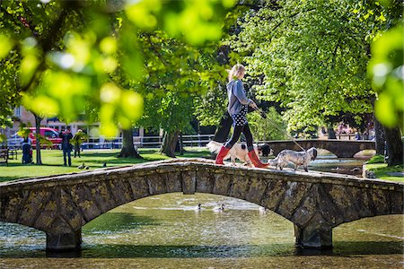 Stone, arch bridge crossing River Windrush, Bourton-on-the-Water, Gloucestershire, The Cotswolds, England, United Kingdom Stock Photo - Rights-Managed, Code: 700-08122117