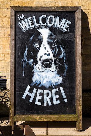 Close-up of sign, welcoming dogs, Bourton-on-the-Water, Gloucestershire, The Cotswolds, England, United Kingdom Stock Photo - Rights-Managed, Code: 700-08122112
