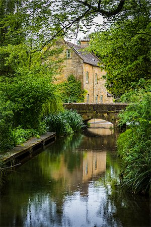 Small, arch bridge over River Windrush, Naunton, Gloucestershire, The Cotswolds, England, United Kingdom Stock Photo - Rights-Managed, Code: 700-08122141