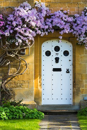 quaint house - Close-up of doorway with flowering vine, Broadway, Worcestershire, The Cotswolds, England, United Kingdom Stock Photo - Rights-Managed, Code: 700-08122179