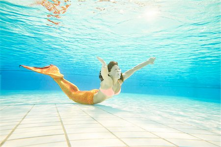 Portrait of Teenage Girl with Mermaid Tail Underwater Stock Photo - Rights-Managed, Code: 700-08122204