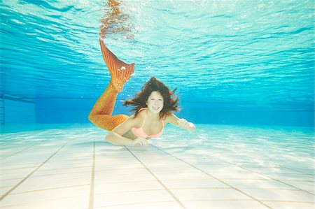 Portrait of Teenage Girl with Mermaid Tail Underwater Stock Photo - Rights-Managed, Code: 700-08122205