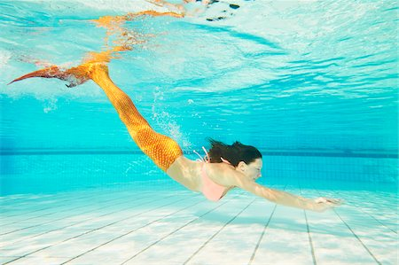 Portrait of Teenage Girl with Mermaid Tail Underwater Stock Photo - Rights-Managed, Code: 700-08122206