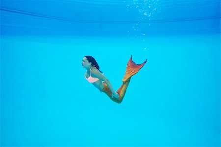 Portrait of Teenage Girl with Mermaid Tail Underwater Stock Photo - Rights-Managed, Code: 700-08122208