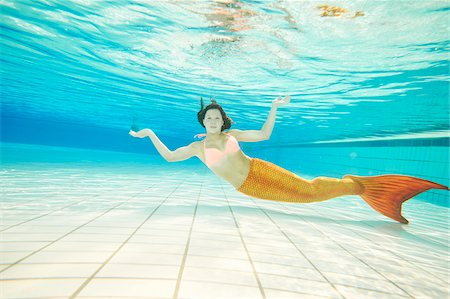 Portrait of Teenage Girl with Mermaid Tail Underwater Stock Photo - Rights-Managed, Code: 700-08122202