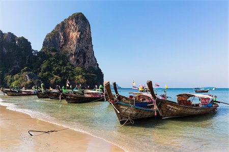 Longtail Boats Anchored on Beach, East Railay Beach, Krabi Province, Thailand Stock Photo - Rights-Managed, Code: 700-08122341