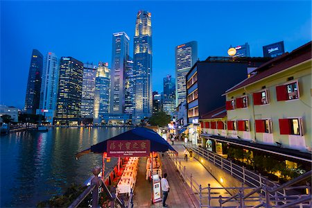 Restaurants and Bars along Boat Quay beneath Skyline at Dusk, Central Region, Singapore Stock Photo - Rights-Managed, Code: 700-08167186