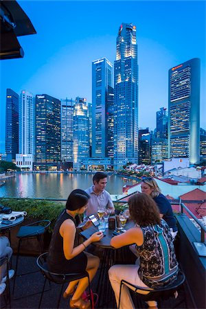 People at Bar at Boat Quay overlooking Skyline at Dusk, Singapore Stock Photo - Rights-Managed, Code: 700-08167182
