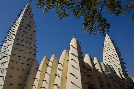 Close-up of towers of the Grand Mosque in Bobo with stepping sticks for maintenance, Bobo-Dioulasso, Houet Province, Burkina Faso Fotografie stock - Rights-Managed, Codice: 700-08169179