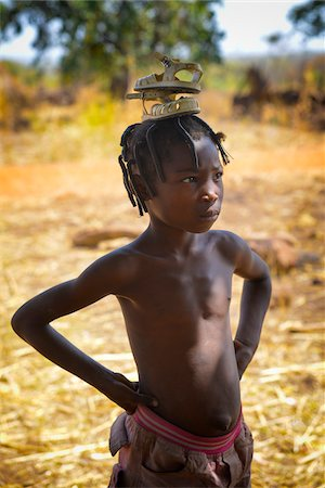Portrait of girl carrying sandals on her head, near Gaoua, Poni Province, Burkina Faso Stock Photo - Rights-Managed, Code: 700-08169185