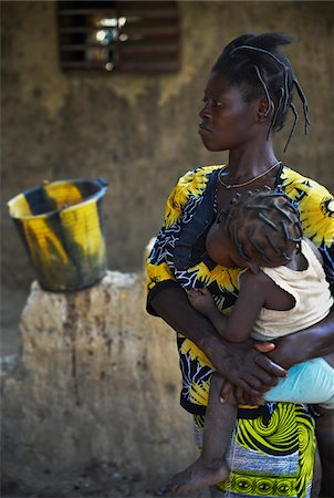 Mother holding child in arms while nursing, black and yellow patterns, Gaoua, Poni Province, Burkina Faso Stock Photo - Rights-Managed, Code: 700-08169189