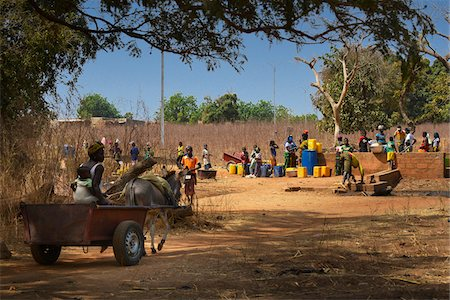 Village people getting water from pump, near Dandougou, Burkina Faso Stock Photo - Rights-Managed, Code: 700-08171608