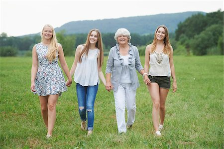 senior lady walking - Portrait of Grandmother with Granddaughters Walking Hand in Hand Outdoors, Bavaria, Germany Stock Photo - Rights-Managed, Code: 700-08209748