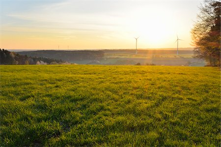 scenic view - Meadow in Spring at Sunrise with Wind Turbines in background, Schippach, Miltenberg, Odenwald, Bavaria, Germany Stock Photo - Rights-Managed, Code: 700-08225282