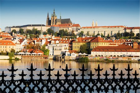 Wrought iron fence and harbor scene with St Vitus Cathedral in background at sunset, Prague, Czech Republic Stock Photo - Rights-Managed, Code: 700-08232188
