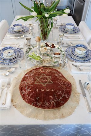 Fully Set Passover Seder Table with Seder Plate and Matzah Cover Stock Photo - Rights-Managed, Code: 700-08274219