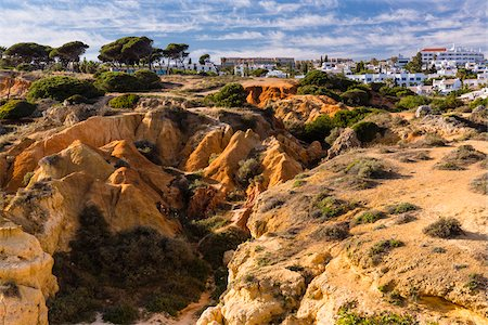 portugal - Eroding landscape at Praia de Sao Rafael with town in background, Albufeira, Algarve, Portugal Stock Photo - Rights-Managed, Code: 700-08274387