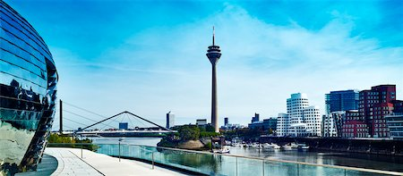 View of the Rheinturm Dusseldorf (TV Tower) in Media Harbour with Neuer Zollhof  on the right, Dusseldorf, Germany Stock Photo - Rights-Managed, Code: 700-08353442