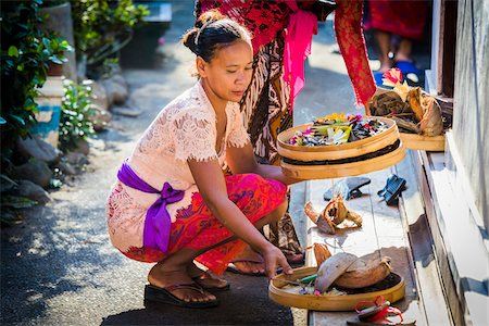 Woman placing religious offering on doorstep at a Balinese wedding, Petulu Village near Ubud, Bali, Indonesia Stock Photo - Rights-Managed, Code: 700-08385844