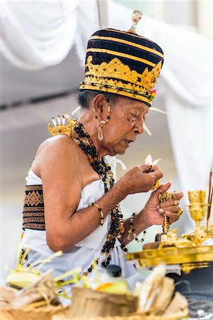 Hindu priest at a Balinese ceremony in Junjungan, near Ubud, Bali, Indonesia Stock Photo - Rights-Managed, Code: 700-08385848
