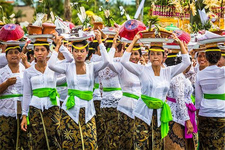 female only - Women carrying religious offerings on their heads at a cremation ceremony for a high priest in Ubud, Bali, Indonesia Stock Photo - Rights-Managed, Code: 700-08385842