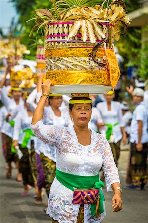 Women carrying religious offerings on their heads at a cremation ceremony for a high priest in Ubud, Bali, Indonesia Stock Photo - Rights-Managed, Code: 700-08385843