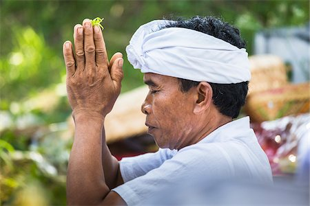 Close-up of man praying at a temple festival, Gianyar, Bali, Indonesia Stock Photo - Rights-Managed, Code: 700-08385855