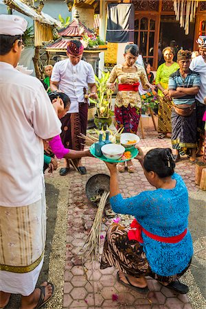 Woman holdng religious offering at Balinese wedding, Petulu Village near Ubud, Bali, Indonesia Stock Photo - Rights-Managed, Code: 700-08385865