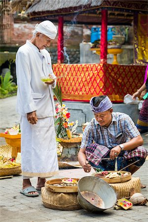 Hindu priest watches man light incense at a Bulan Pitung Dina (One Month and One Week) purification ceremony for baby and parents, Ubud, Bali, Indonesia Stock Photo - Rights-Managed, Code: 700-08385867