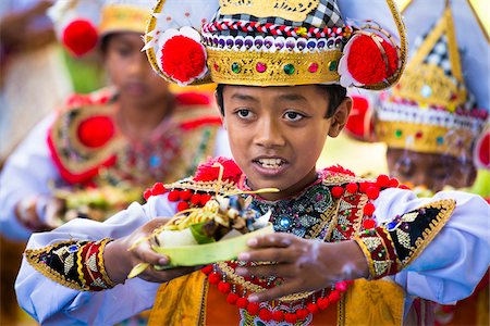 Young Baris dancers at a temple festival, Gianyar, Bali, Indonesia Stock Photo - Rights-Managed, Code: 700-08385881