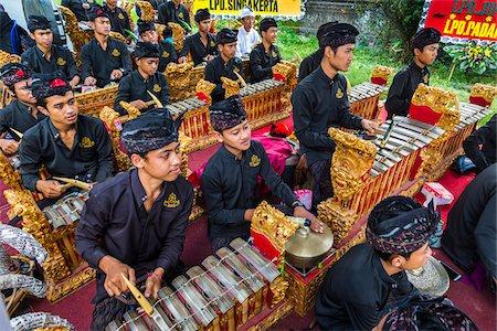Gamelan slenthem players, at a Balinese ceremony in Junjungan, near Ubud, Bali, Indonesia Stock Photo - Rights-Managed, Code: 700-08385882