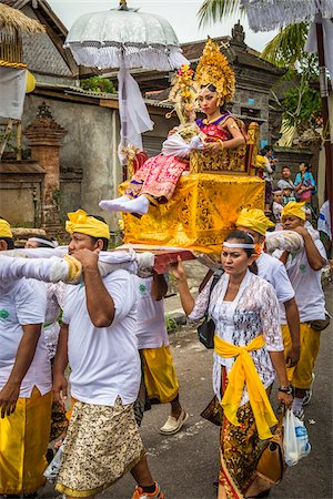 Woman being carried in a raised chair by people in a parade at a cremation ceremony for a high priest in Ubud, Bali, Indonesia Stock Photo - Rights-Managed, Code: 700-08385896