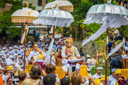 People being carried in raised chairs in pararde at a cremation ceremony for a high priest in Ubud, Bali, Indonesia Stock Photo - Rights-Managed, Code: 700-08385898
