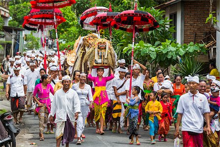 People carrying Sacred Barongs in a parade at a temple festival in Petulu village, near Ubud, Bali, Indonesia Stock Photo - Rights-Managed, Code: 700-08385891