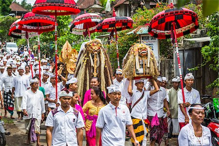 People carrying sacred Barongs in a parade at a temple festival in Petulu Village, near Ubud, Bali, Indonesia Stock Photo - Rights-Managed, Code: 700-08385892