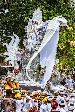 People carrying an elaborate parade float at a cremation ceremony for a high priest in Ubud, Bali, Indonesia Stock Photo - Rights-Managed, Code: 700-08385902