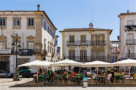Cafe with outside seating by city buildings with the typical wrought iron balustrades, historic city centre, UNESCO World Heritage Site, Evora, Alentejo, Portugal Stock Photo - Rights-Managed, Code: 700-08519517