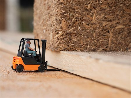 equipment - Close-up of toy figure driving toy forklift on wooden shipping pallets Stock Photo - Rights-Managed, Code: 700-08548006