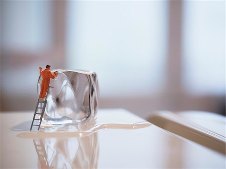 Miniature figure of window cleaner washing an ice cube on top of a fridge Stock Photo - Rights-Managed, Code: 700-08548008