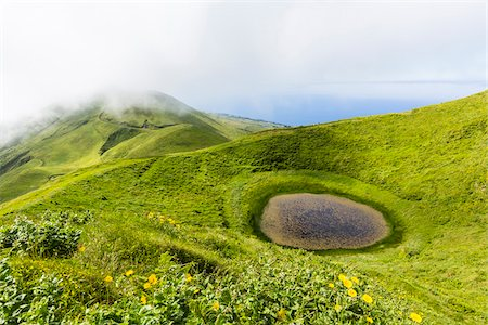 portuguese (places and things) - Highlands with a small crater lake in front of the volcanic formation of Pico Verde, Norte Grande, Sao Jorge Island, Azores, Portugal Stock Photo - Rights-Managed, Code: 700-08540042