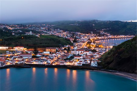 Elevated view of the city of Horta, illuminated at dusk, viewed from Monte da Guia, Faial Island, Azores, Portugal Stock Photo - Rights-Managed, Code: 700-08540099