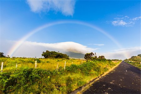Rural scene with paved road and rainbow above the cloud covered Mount Pico (2351 m), Pico Island, Azores, Portugal Stock Photo - Rights-Managed, Code: 700-08567247