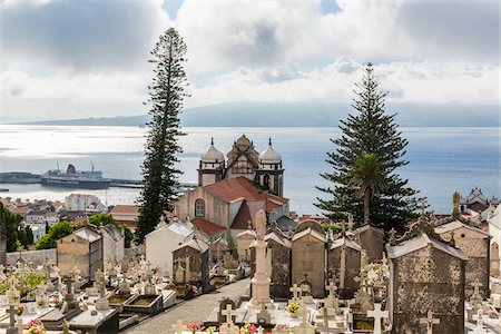 portugal - View of the Church of Nossa Senhora do Carmo and graveyard with Mount Pico (2351 m) on Pico Island in the distance, Horta, Faial Island, Azores, Portugal Stock Photo - Rights-Managed, Code: 700-08567252