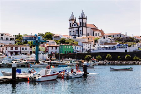 Dock and fishing harbour with main Church of Sao Mateus da Calheta, Sao Mateus da Calheta, Terceira Island, Azores, Portugal Stock Photo - Rights-Managed, Code: 700-08576079