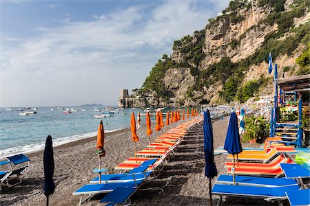 Colorful umbrellas and loungers on a gravel beach near Positano, Amalfi Coast, Campania, Italy Stock Photo - Rights-Managed, Code: 700-08576150