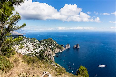 Elevated view of Capri and the Marina Piccola with the Faraglioni cliffs, the Sorrento Peninsula in the distance, Tyrrhenian Sea, Gulf of Naples, Campania, Italy Stock Photo - Rights-Managed, Code: 700-08576184