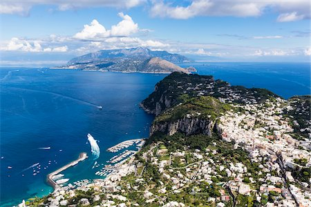 Elevated view of Capri and harbour with the Sorrento Peninsula in the background, Island of Capri, Tyrrhenian Sea, Gulf of Naples, Campania, Italy Stock Photo - Rights-Managed, Code: 700-08576183