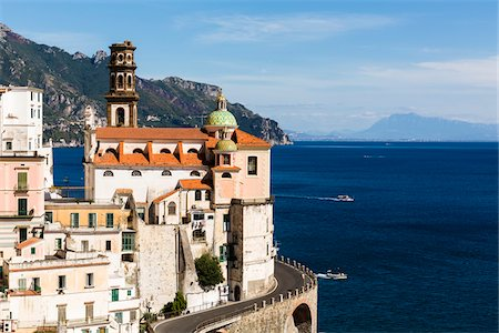 Coastal road curving around buildings with the Church of Santa Maria Maddalena looking out onto the Tyrrhenian Sea, Atrani, Amalfi Coast, Italy Stock Photo - Rights-Managed, Code: 700-08639303