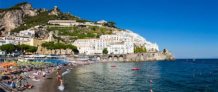 Tourists enjoying the beach at the mountain side town of Amalfi, Amalfi Coast, Italy Stock Photo - Rights-Managed, Code: 700-08639322