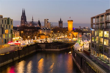 Elevated view at dusk with the illuminated Christmas Market by the Malakowturm and the Chocolate Museum (Imhoff Schokoladenmuseum) at Rheinauhafen with the Cologne Church (Dom) in the background, Cologne, Germany Stock Photo - Rights-Managed, Code: 700-08639339